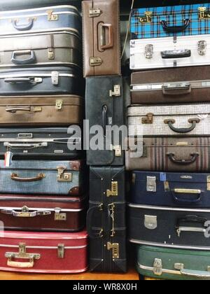 Full Frame Shot Of Old-fashioned Suitcase Stack - Stock Photo