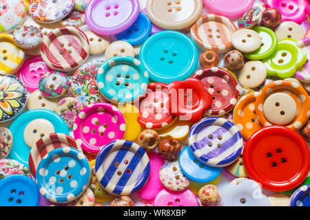 Full frame and selective focus photo of various and colorful sewing buttons. - Stock Photo