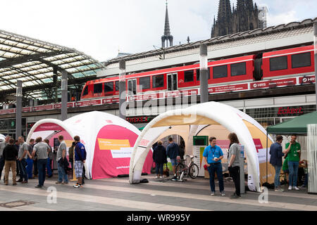 job exchange of Deutsche Bahn (German Railway) in front of the main station on Breslauer Platz, Cologne, Germany.  Jobboerse der Deutschen Bahn vor de - Stock Photo