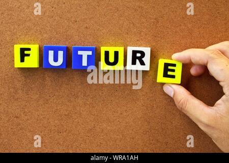 Close-up Of Human Hand Arranging Blocks With Texts - Stock Photo