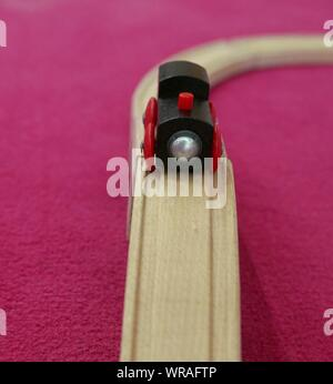 Toy Train On Wooden Railroad Track - Stock Photo