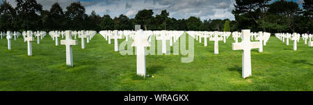 Omaha Beach, Normandy / France - 16 August 2019: panorama view of headstones in the American Cemetery at Omaha Beach in Normandy - Stock Photo