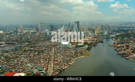 Manila city with skyscrapers, modern buildings and Makati business center, aerial drone. Travel vacation concept. - Stock Photo