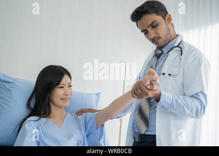 The doctor examined the condition of the patient with shoulder pain. - Stock Photo