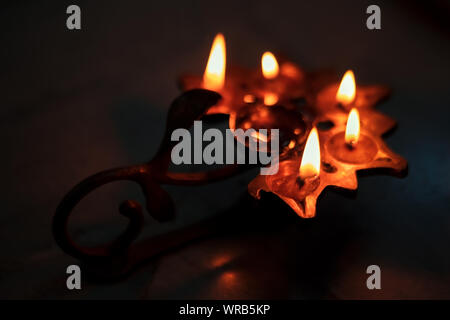 Happy durga puja or diwali background image with copy space. Traditional oil lamp or diya at night time to celebrate Indian hindu festival. - Stock Photo