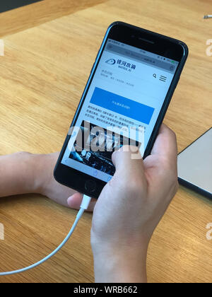 A Chinese netizen browses the website of AI technology company Watrix on his Apple iPhone smartphone in Beijing, China, July 23rd, 2019. - Stock Photo
