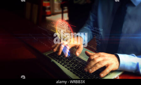 Man typing on laptop with bulb symbol hologram screen over keyboard. Concept of new idea, success, business, creativity, invention and innovation with - Stock Photo