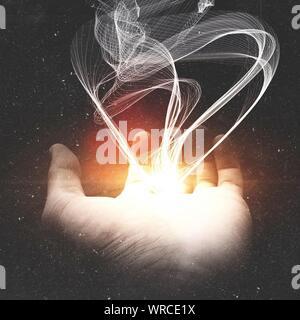 Digitally Generated Image Of Smoke Emitting From Glowing Hand Against Black Background - Stock Photo