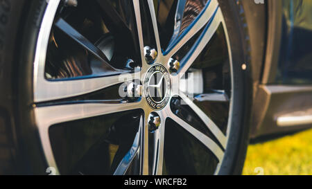 09.05.2019 - Kyiv, Ukraine: Presentation of new car mersedes, outdoors. Close-up of wheel car - Stock Photo