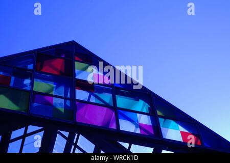Low Angle View Of Colorful Houses Against Clear Blue Sky - Stock Photo