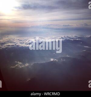 Scenic View Of Sunlight Shining Through Clouds - Stock Photo