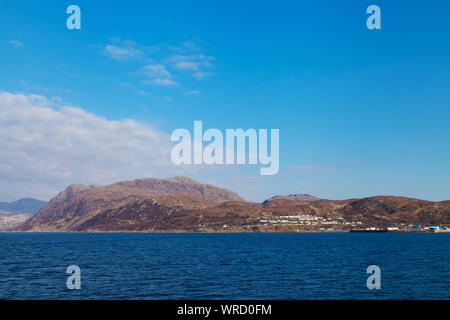 The harbour town of Mallaig in the Highlands of Scotland from a ferry heading to Rum. - Stock Photo