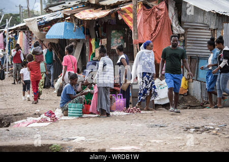 ARBA MINCH, ETHIOPIA-OCTOBER 27, 2018: Unidentified merchants sell vegetables and other wares at a market in Arba Minch, Ethiopia. - Stock Photo