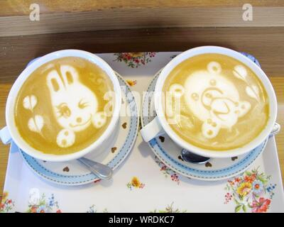 Teddy Bear And Heart Shapes In Coffee Foam - Stock Photo