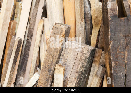 Wood storage with old wooden beams and woodcut for use in workshop, Holzwerksatt - Stock Photo