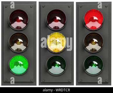 Set of three lit UK traffic lights sequence showing Green, Amber and Red in turn on a white background - Stock Photo