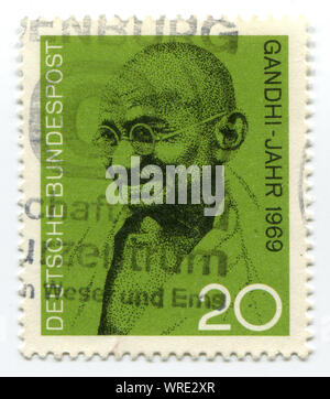 postage stamp printed in Germany showing Mohandas Karamchand Gandhi, circa 2004 - Stock Photo