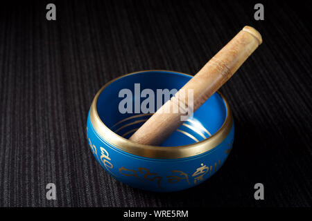 Tibetan bowl on a table. - Stock Photo