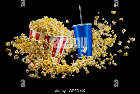 Set of paper striped bucket with popcorn and cup of soft drink isolated on black - Stock Photo