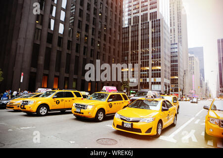 NEW YORK - AUGUST 23: View to New Yorks taxicabs at the 5th Av on August 23, 2015. The taxicabs of New York City are widely recognized icons of the ci - Stock Photo