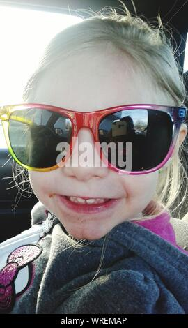 Close-up Of Girl Wearing Sunglasses In Car - Stock Photo