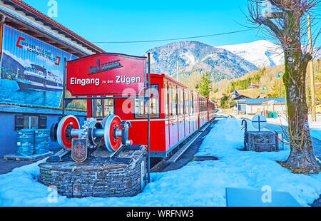 ST WOLFGANG, AUSTRIA - FEBRUARY 23, 2019: The vintage red train of Schafberg cog-railway at the lower station, on February 23 in St Wolfgang - Stock Photo