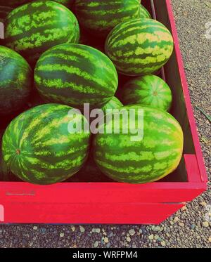 High Angle View Of Watermelons In Crate For Sale At Street Market - Stock Photo