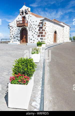 The small chapel Ermita de San Bartolome in the east of La Palma, Spain with some flower pots leading to it. - Stock Photo