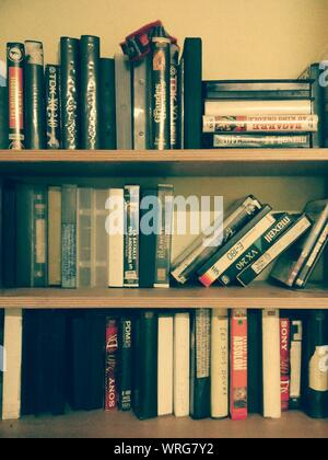 Books And Videocassette On Shelves - Stock Photo