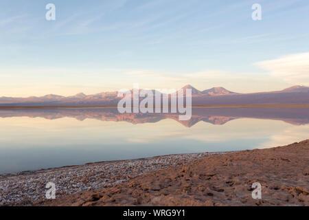 Reflection at sunset in laguna Chaxa, Chile - Stock Photo
