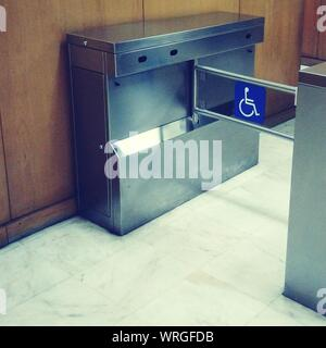 Disabled Sign On Metal In Building - Stock Photo