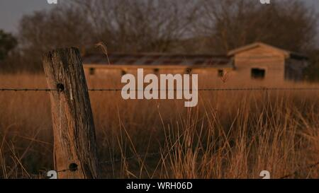 Close-up Of Fence On Grassy Field - Stock Photo