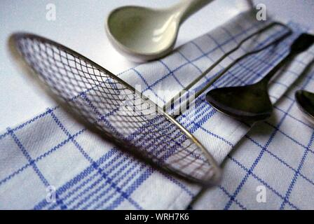 High Angle View Of Kitchen Utensils And Napkin On Table - Stock Photo