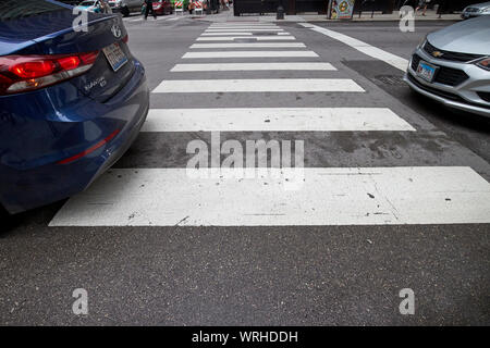 gap between cars on crosswalk in the loop central city of chicago Chicago Illinois USA - Stock Photo