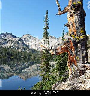 Scenic View Of Alice Lake By Sawtooth Mountains Against Sky - Stock Photo