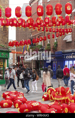 London, UK. 10th Sep, 2019. 10 September 2019. London, UK.Chinatown in Soho prepares for Chinese traditional mid-autumn festival with strings of decorated red lanterns strung above the street. Credit Peter Hogan/Alamy Credit: Peter Hogan/Alamy Live News - Stock Photo