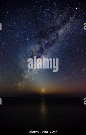 Idyllic Shot Of Milky Way Over Sea Against Sky - Stock Photo