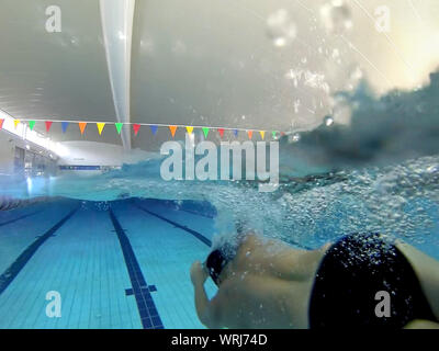 Underwater Shot Of Male Swimmer In Pool - Stock Photo