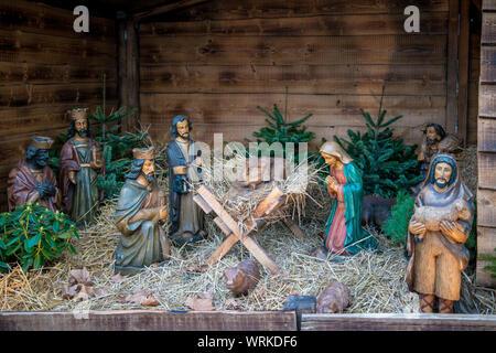 Christmas nativity scene big figurines in daily light - Stock Photo