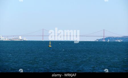 25 De Abril Bridge Over River Against Clear Sky - Stock Photo