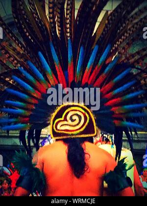 Rear View Of Shirtless Man Wearing Headdress During Celebration - Stock Photo