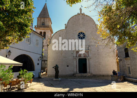 Beautiful historical old town main square of Osor on Cres island with assumption of Mary st. gaudentius church - Stock Photo
