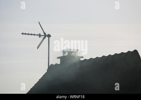 Low Angle View Of Smoke Emitting From Chimney Against Sky - Stock Photo