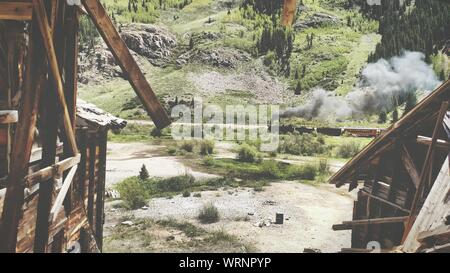 High Angle View Of Smoke Emitting Train At Old Village - Stock Photo