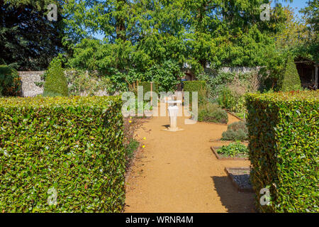 Sundial in the Physic Garden, a public botanical herb garden of medicinal plants, in the market town of Petersfield, Hampshire, southern England, UK - Stock Photo
