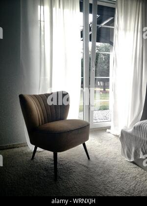Upholstered Chair In Front Of Closed Glass Doors - Stock Photo