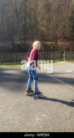 Girl Inline Skating At Park - Stock Photo