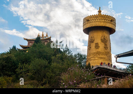 Giant prayer wheel at Zhongdian, also known as Shangri-La, a majority-Tibetan town substantially rebuilt after a disastrous fire in 2014. - Stock Photo
