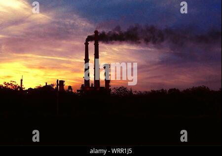 Smoke Emitting From Factory During Sunset - Stock Photo