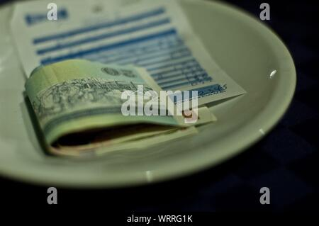 Receipt And Money On Plate - Stock Photo